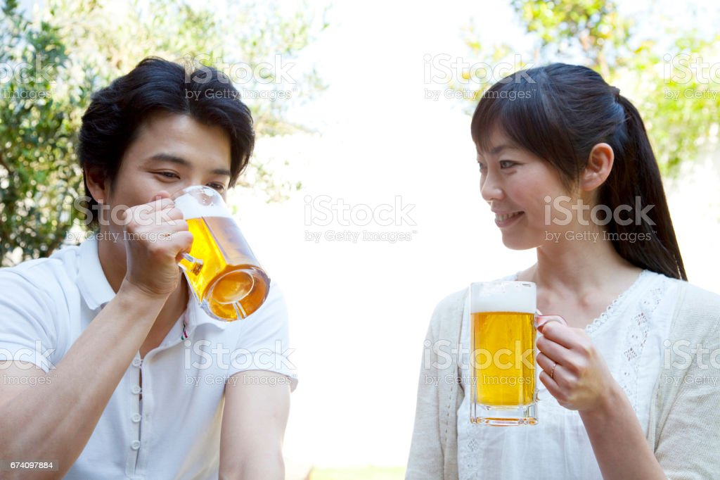 Couple drinking beer in the garden royalty-free stock photo