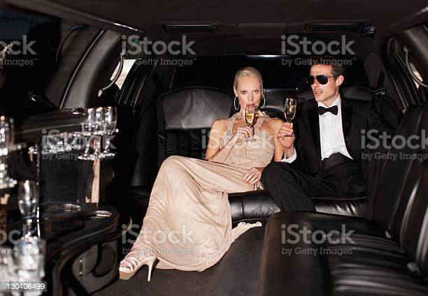 Photo of Couple drinking champagne in limo