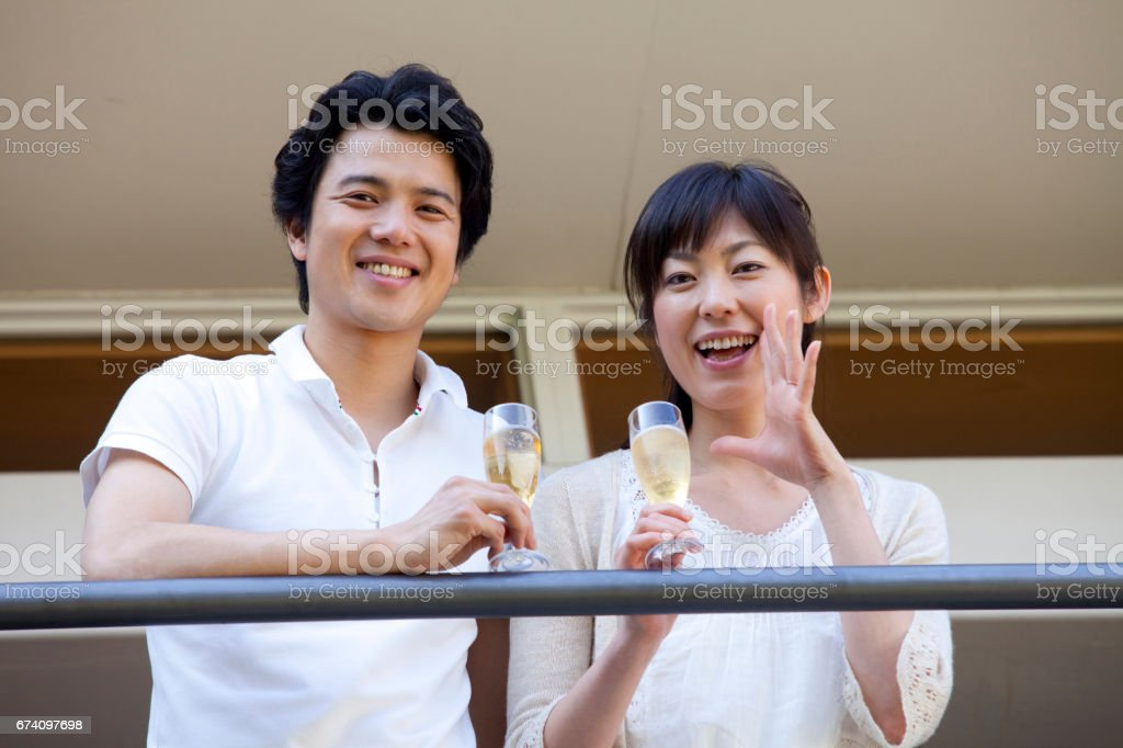 Couple drinking champagne on the balcony royalty-free stock photo