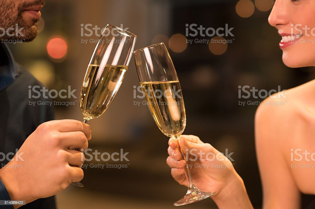 Couple drinking champagne stock photo