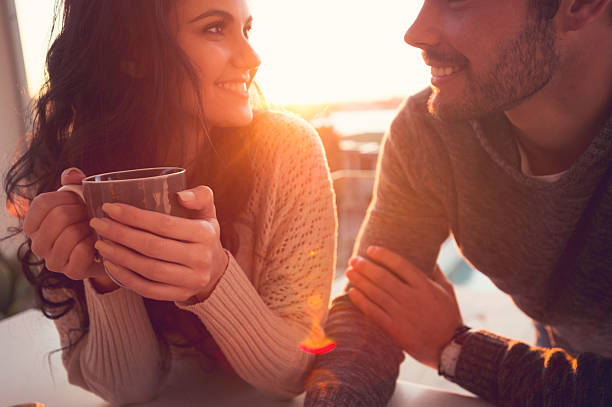 Couple drinking coffee and talking. stock photo