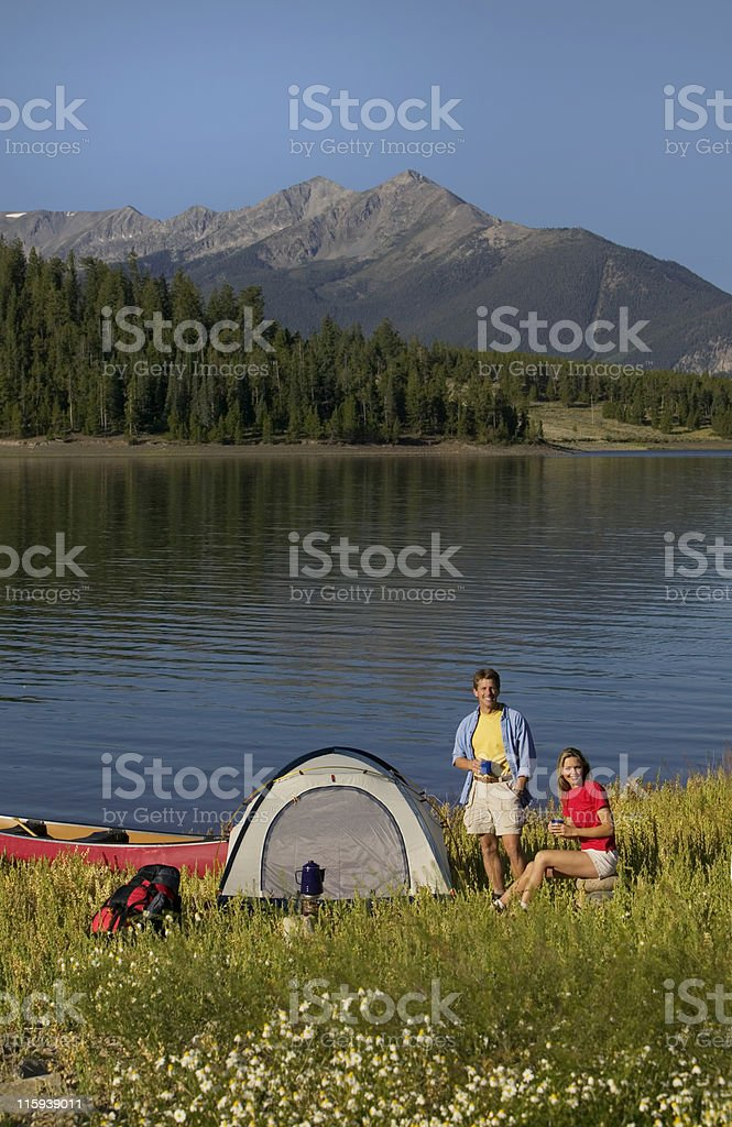 Couple Drinking Coffee at Mountain Lakeside Camp Site royalty-free stock photo