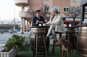 Couple drinking coffee in bar terrace in winter day, coffee and cocoa