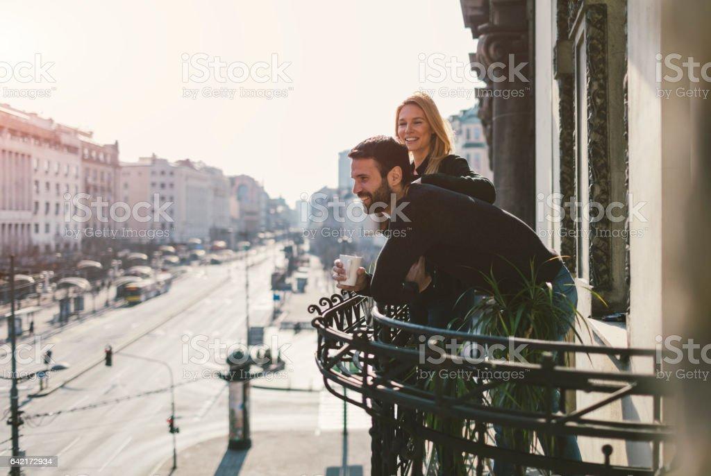 Couple drinking coffee on hotel balcony stock photo