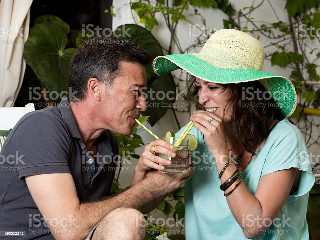 couple drinking soda in a lot of fun way royalty-free stock photo