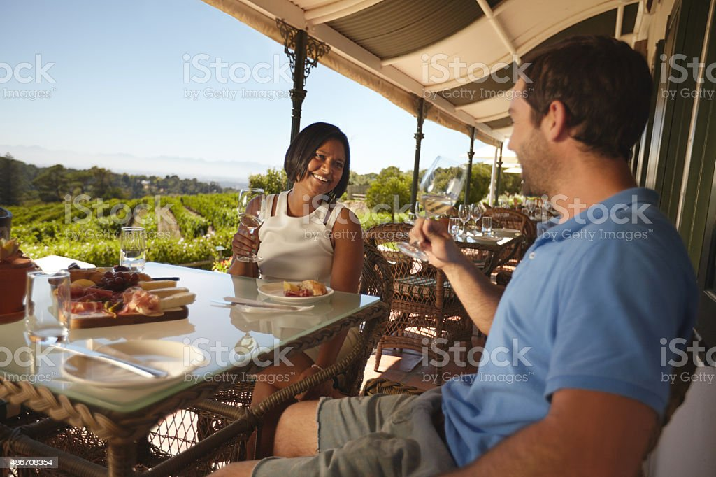 Couple drinking wine at winery restaurant stock photo