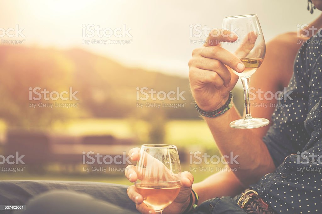 Couple drinking wine in cheerful moment stock photo