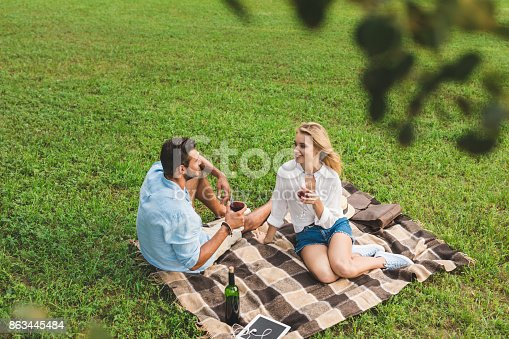 istock couple drinking wine on romantic date 863445484