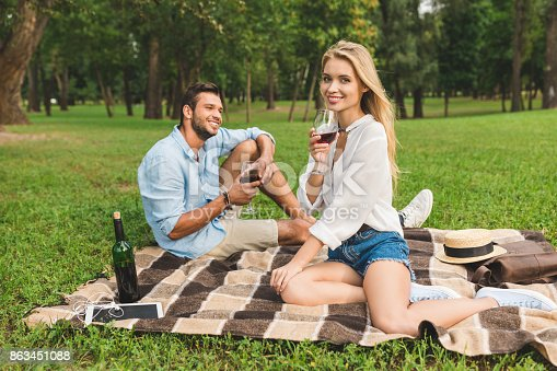 istock couple drinking wine on romantic date 863451088