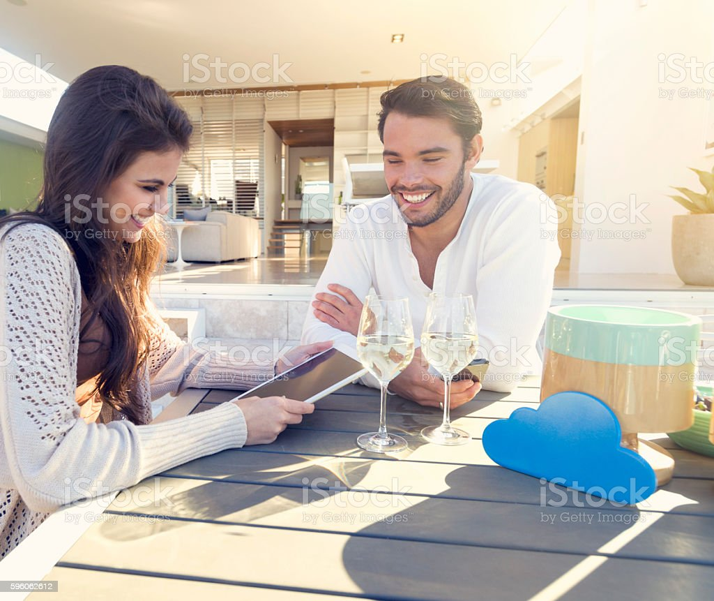 Couple drinking wine on the terrace. royalty-free stock photo