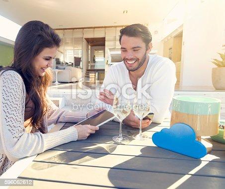 istock Couple drinking wine on the terrace. 596062612