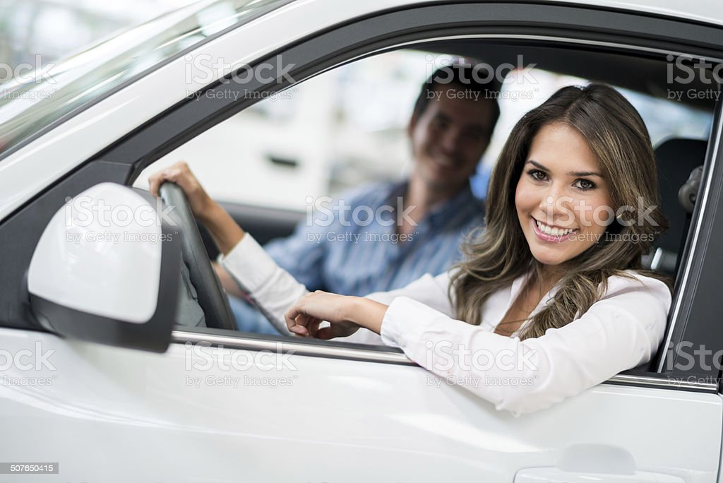 Couple driving a new car stock photo