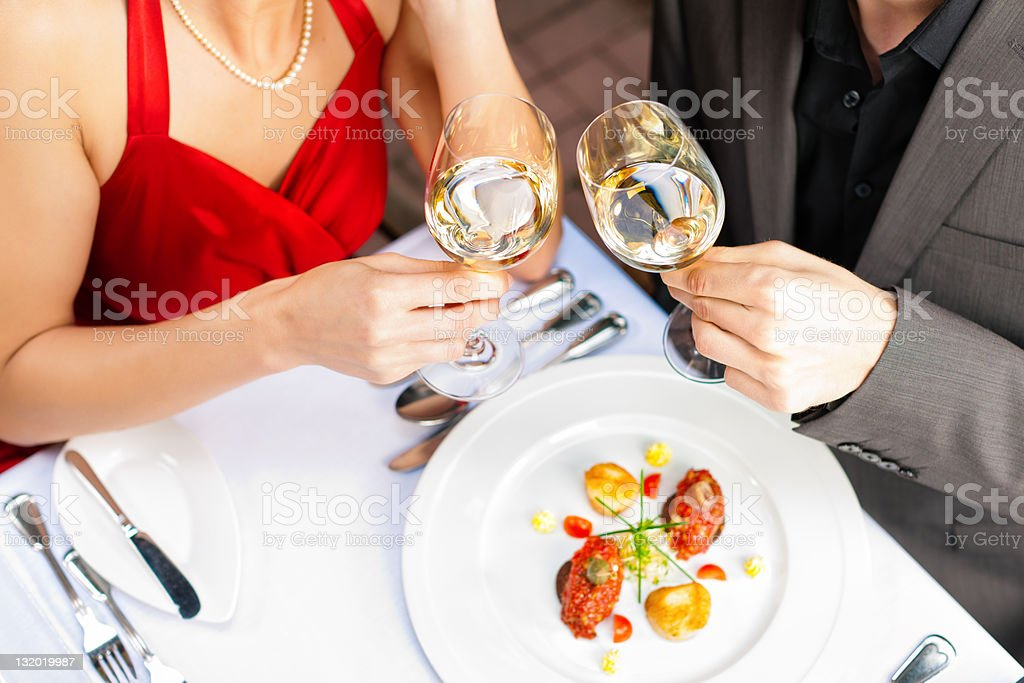 Couple eating and drinking in very good restaurant royalty-free stock photo