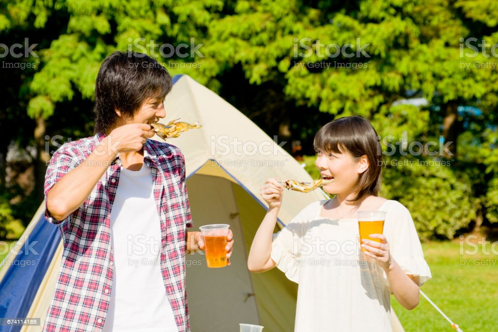 Couple eating barbecue Ayu royalty-free stock photo
