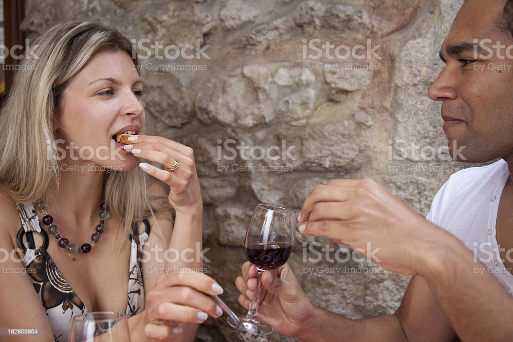 Couple eating bread and drinking red wine stock photo