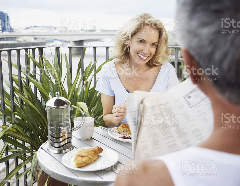 Couple eating breakfast outdoors royalty-free stock photo