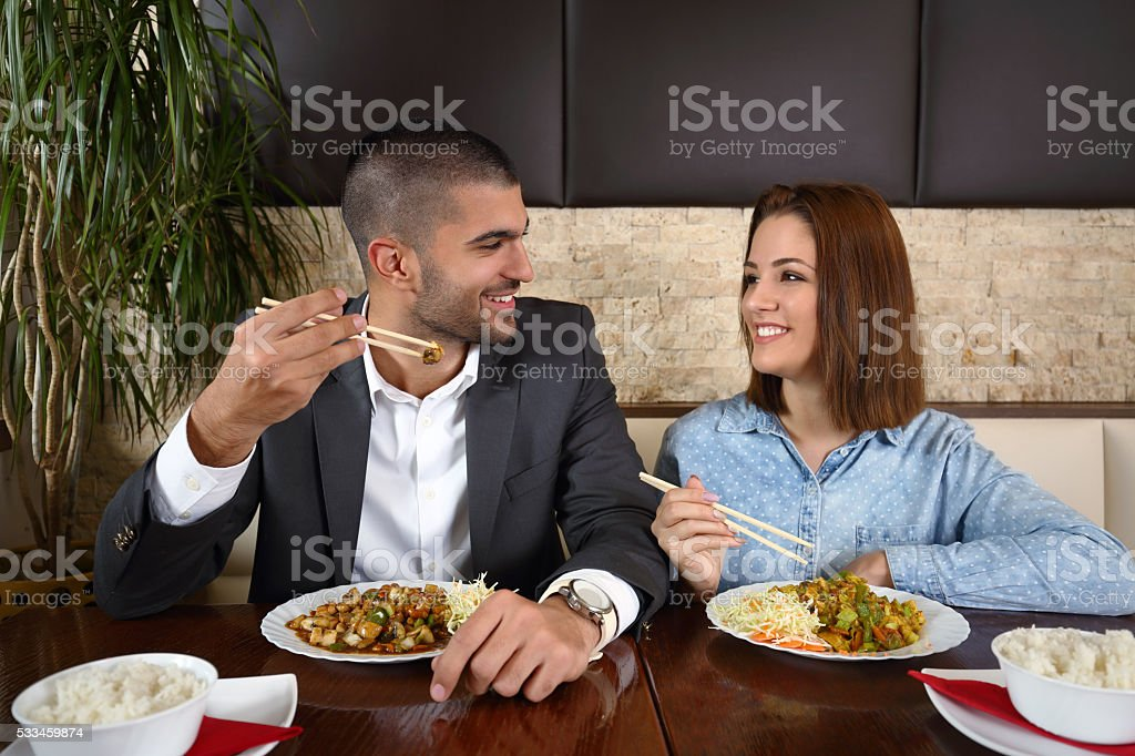 Couple Eating Chinese Food stock photo