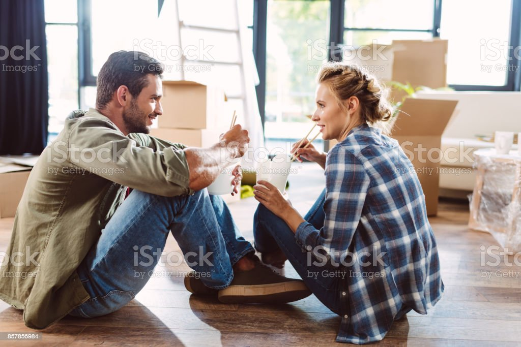 couple eating in new house stock photo