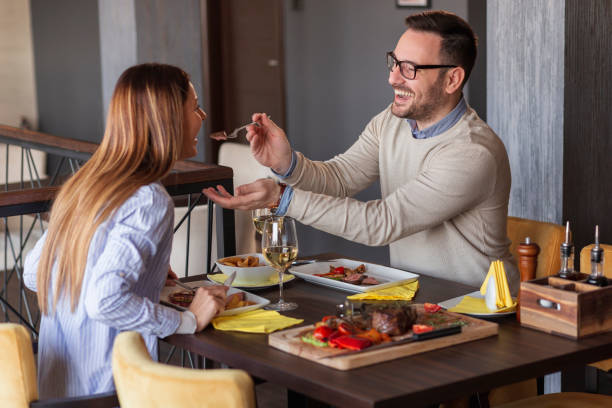 Couple eating in restaurant stock photo