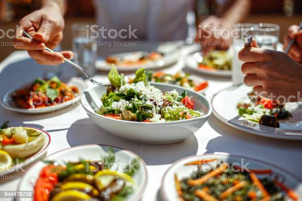 Couple eating lunch with fresh salad and appetizers picture id944478708?b=1&k=6&m=944478708&s=612x612&h=h1n9vrdsmjreja u7n61bbsxm1vtzmthtpfv3bktxli=