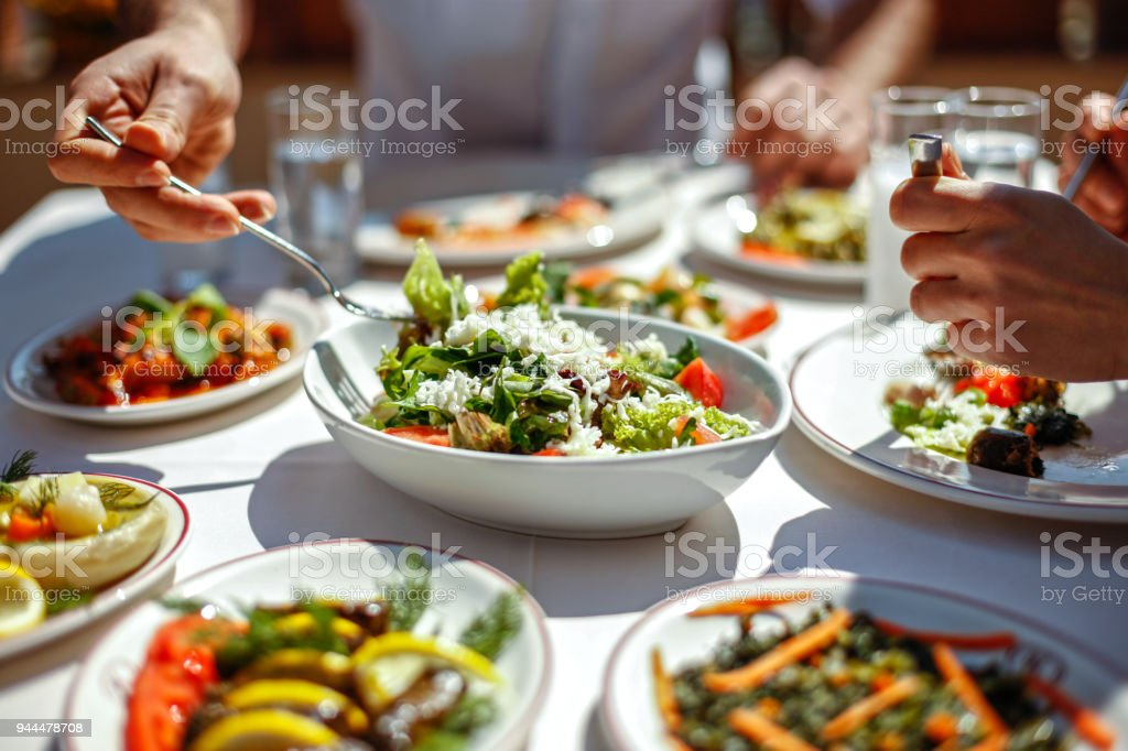 Couple  Eating Lunch with Fresh Salad and Appetizers stock photo