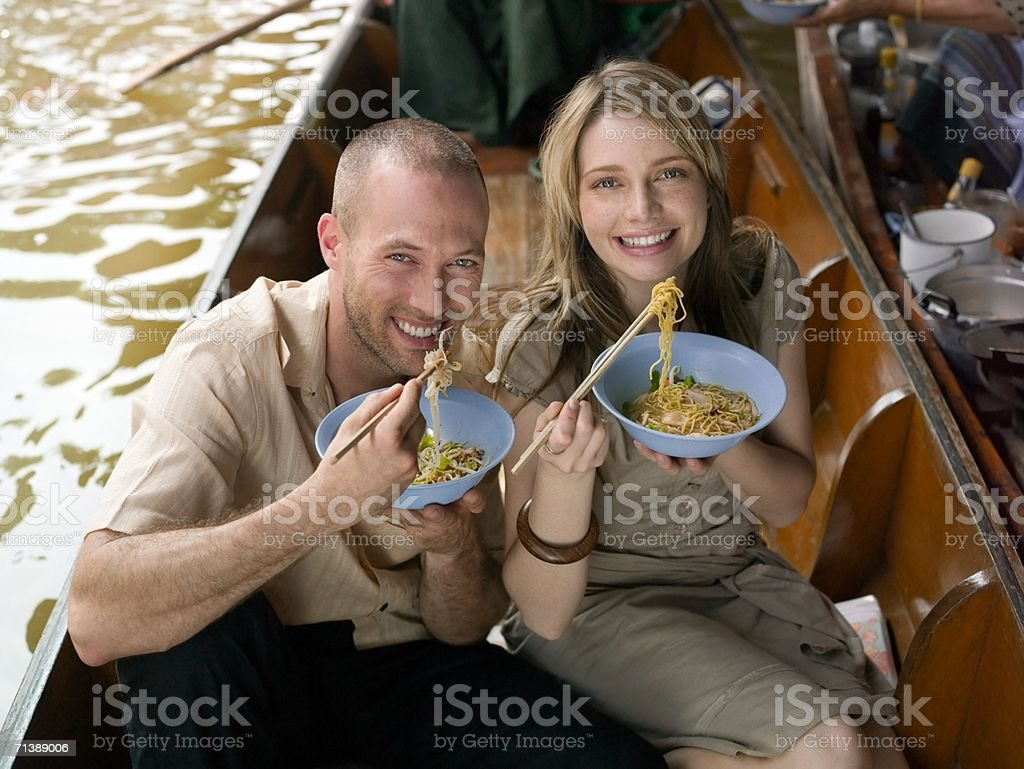 Couple eating meal on river boat royalty-free stock photo