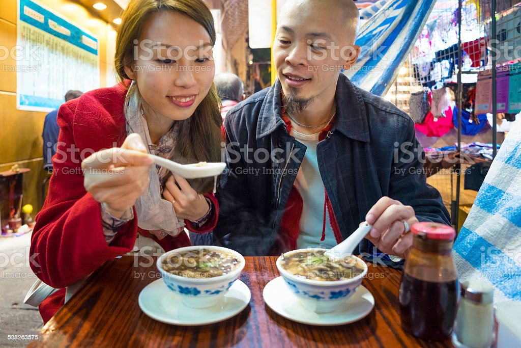 Couple Eating Snake Soup stock photo