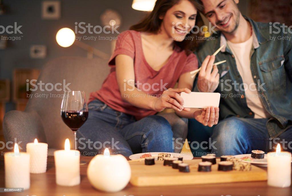 Couple eating tasty sushi for dinner stock photo