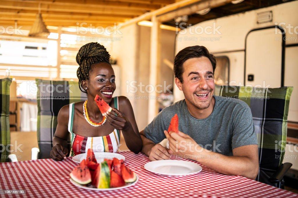 Couple eating watermelon stock photo