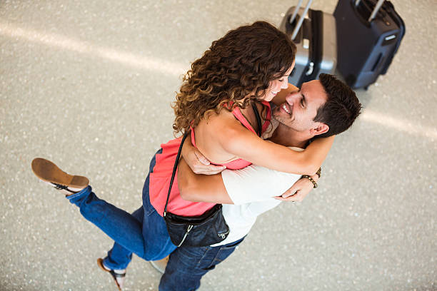 Couple embraced at airport. They are so happy to see each other! long distance relationship stock pictures, royalty-free photos & images