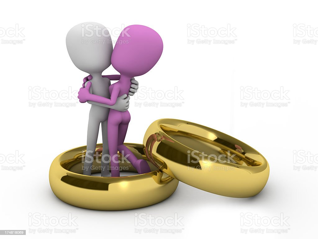 Couple embraced with love and affection within the rings royalty-free stock photo
