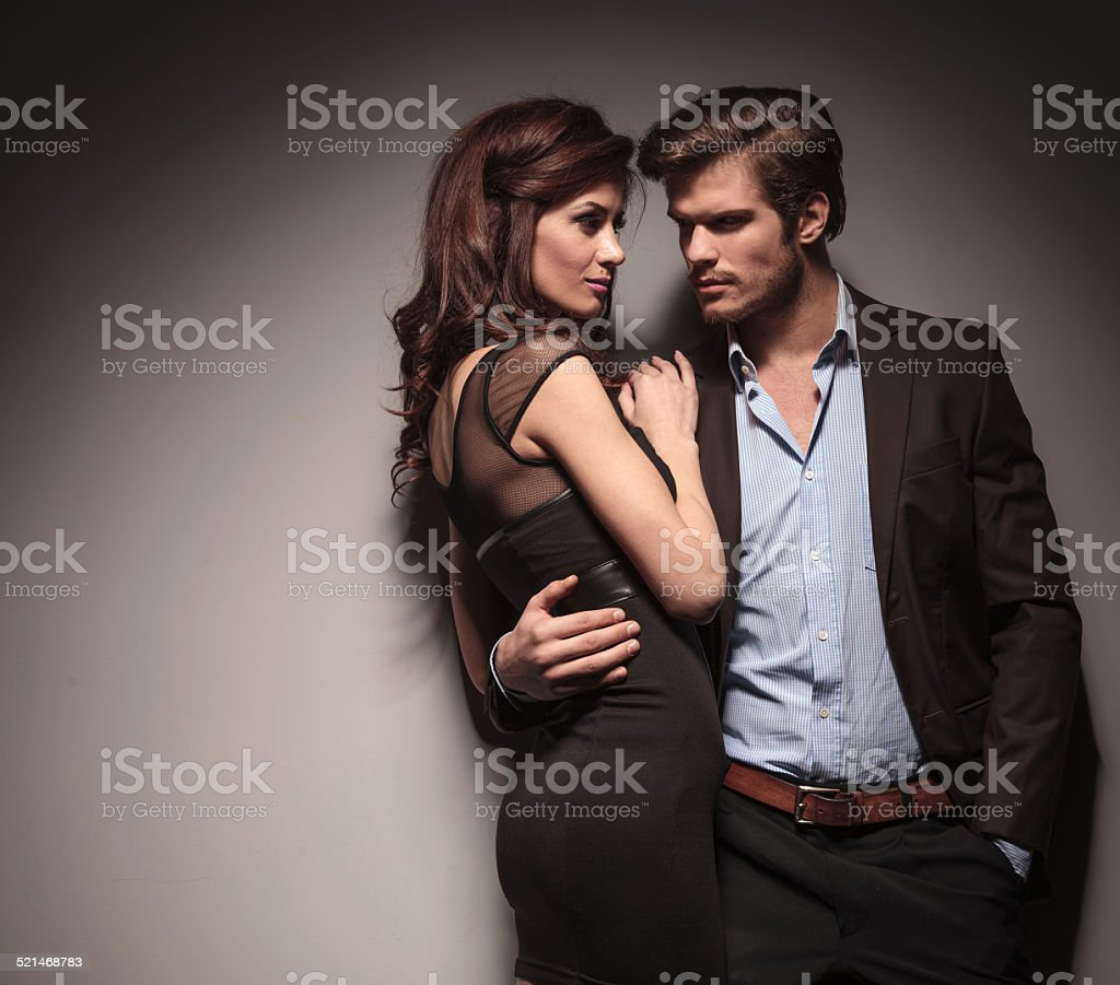 Couple embracing and looking at each other stock photo