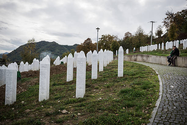 Couple embracing at Srebrenica cemetery stock photo