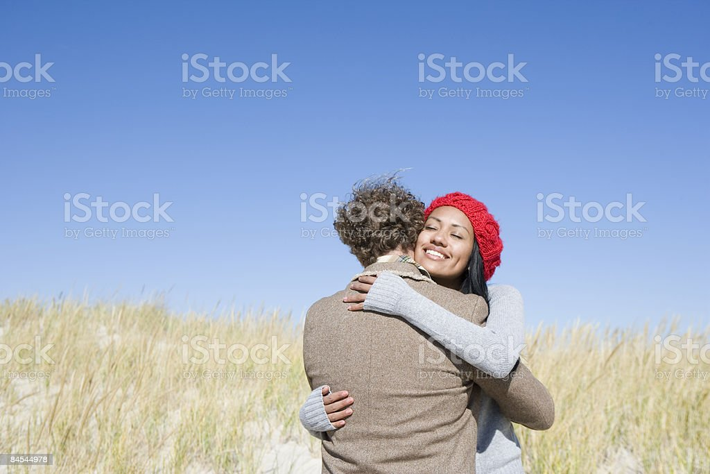 Couple embracing at the beach. royalty-free stock photo