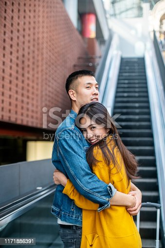 Couple embracing each other at the train station