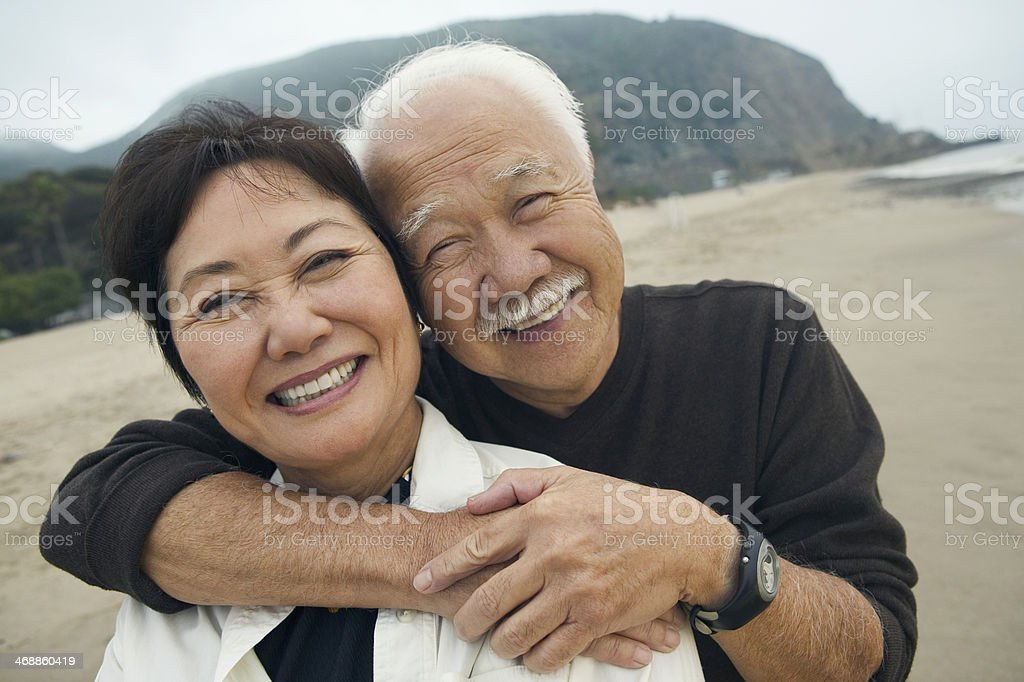 Couple Embracing Each Other On Beach stock photo