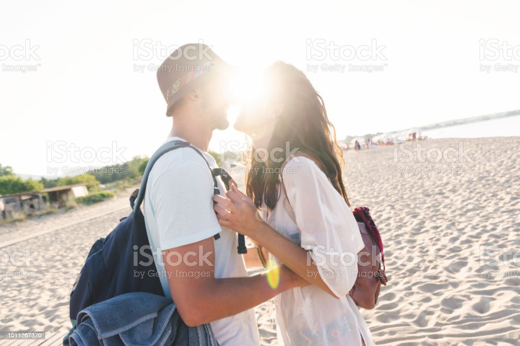 Couple embracing each other on the beach stock photo
