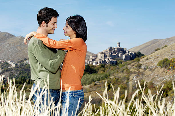 couple embracing in a mountain landscape stock photo