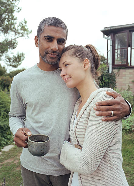 Couple embracing in garden, portrait of man stock photo