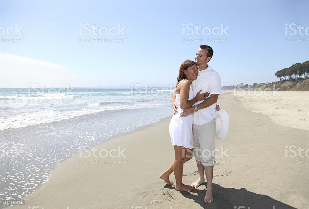 Couple Embracing On The Beach royalty-free stock photo
