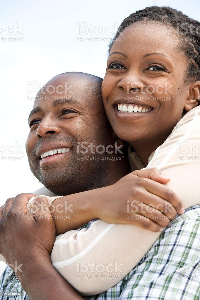 Couple Embracing One Another stock photo
