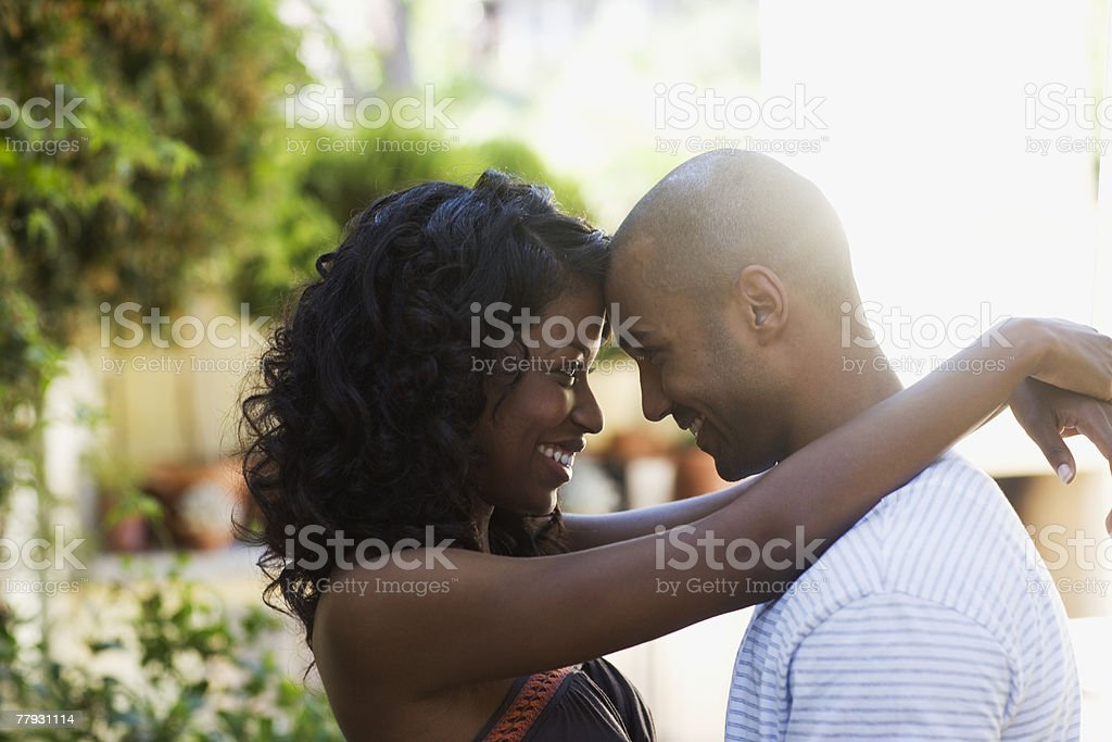 Couple embracing outdoors stock photo