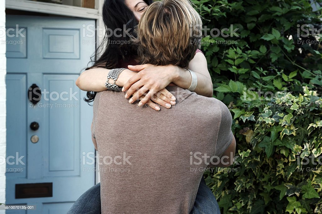 Couple embracing outside house royalty-free stock photo