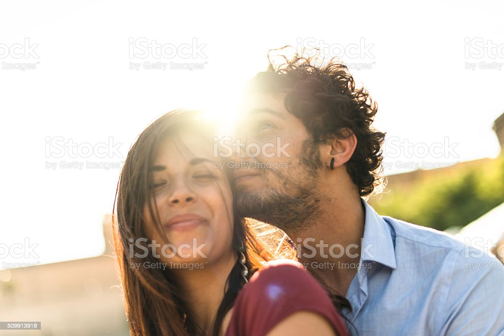 couple embracing togetherness at dusk stock photo