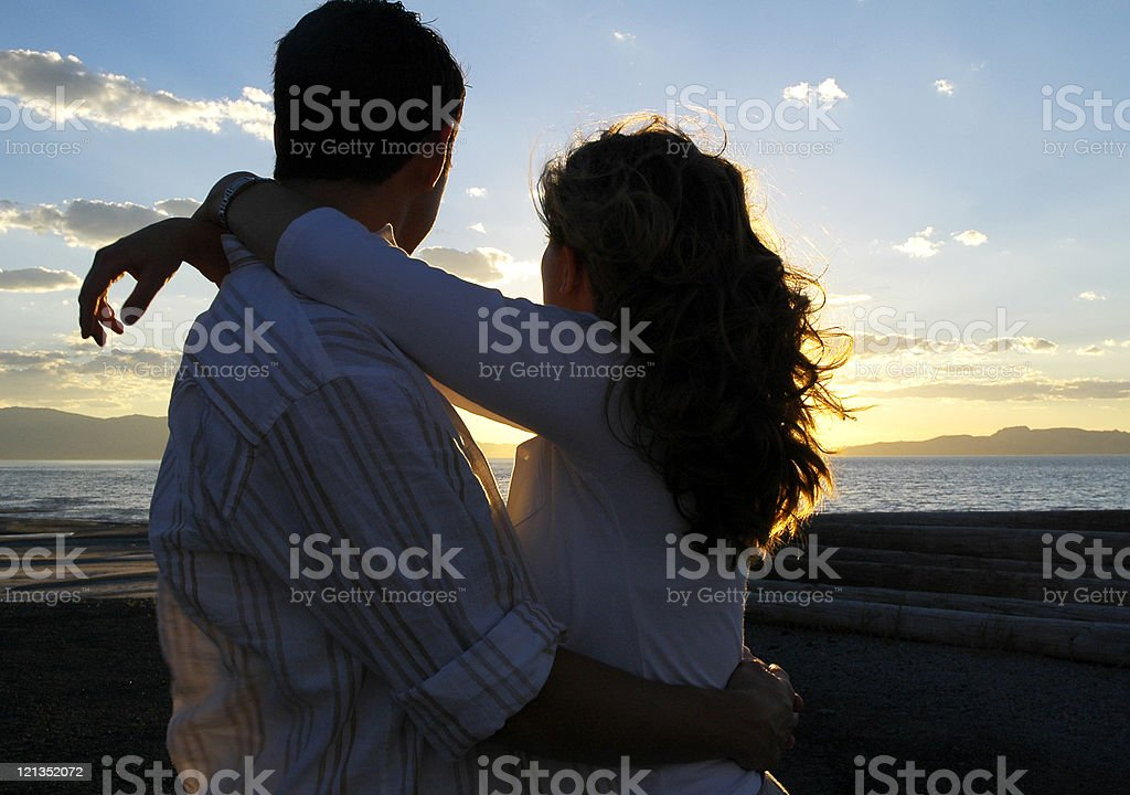 Couple Embracing Watching the Sunset royalty-free stock photo