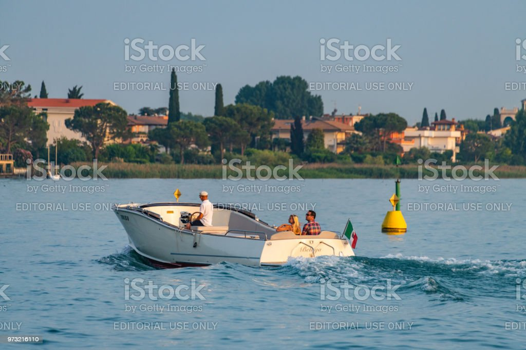 A couple enjoy a boat ride in Sirmione on Lake Garda, Italy stock photo