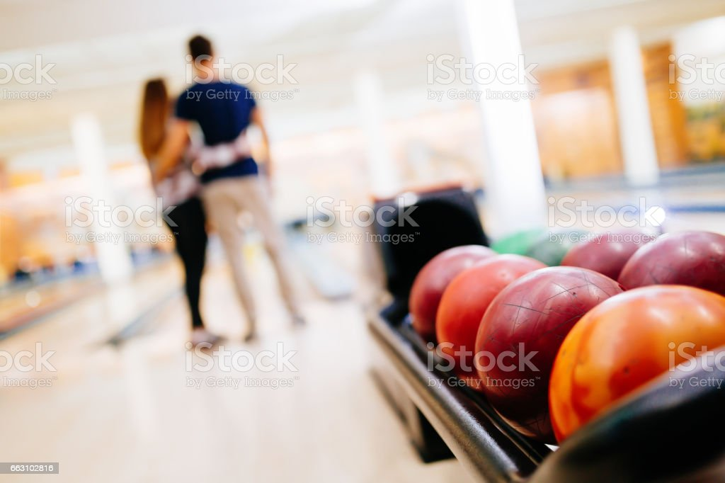 Couple enjoy bowling together  and hugging stock photo