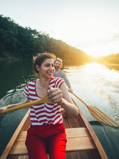 Couple enjoy canoeing stock photo