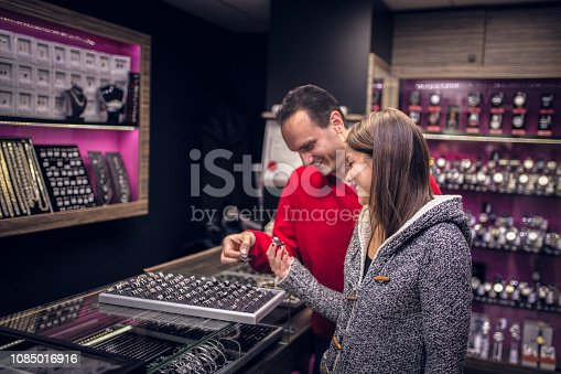 Couple enjoy in Christmas shopping in the jewelry store
