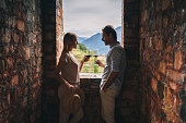 istock Couple enjoy some red wine in ancient Italian castle 1291807006